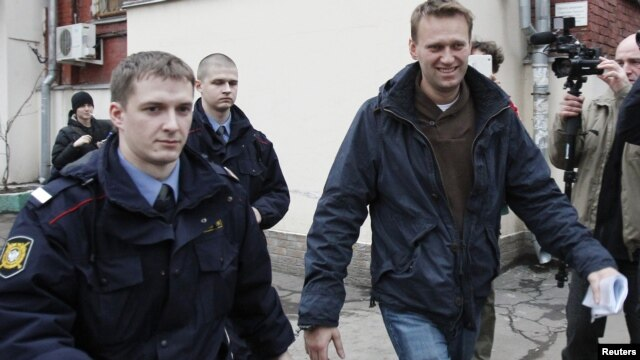 Prominent anticorruption blogger Aleksei Navalny (right) arrives for an appeal hearing at a court in Moscow on December 7. Has the Kremlin made him into an opposition icon by arresting him?