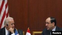 Віце-президент США Джозеф Байден та прем'єр-міністр Іраку Нурі аль-Малікі на прес-конфепенції в Багдаді 30 листопада 2011 року