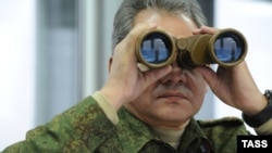 Russian Defense Minister Sergei Shoigu observing military exercises in 2014.