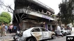 موقع تفجير استهدف مدنيين بحي الكرادة - 10 نيسان 2015