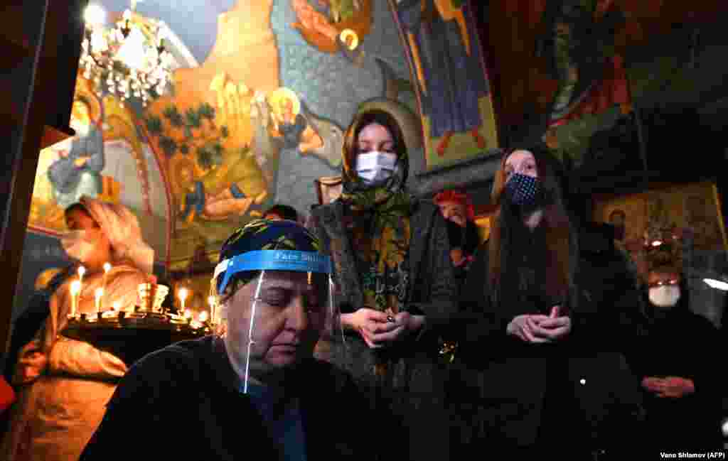 Georgian believers wearing face masks attend a mass marking the Holiday of Annunciation in Tbilisi on April 7. (AFP/Vano Shlamov)