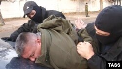 Russian Federal Security Service (FSB) officers detain Dmytro Shtyblikov on suspicion of preparing a terror attack in Crimea, in Sevastopol on November 10.