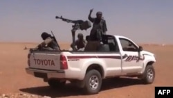 An image grab from a video uploaded on YouTube allegedly shows a Jihadist group in Anbar province (file photo)