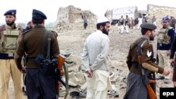 The site of a suicide car bomb attack in Bannu in February 2009