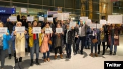 Friends and supporters of Shahab Dehghani, an Iranian student facing deportation from the United States, protesting at Boston's Logan Airport on January 20.
