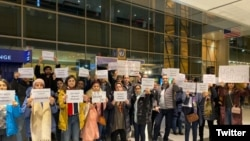 Friends and supporters of Shahab Dehghani, an Iranian student facing deportation from the United States, protesting at Logan Airport. January 20, 2020.