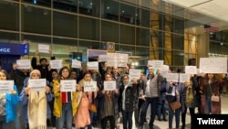 Friends and supporters of Shahab Dehghani, an Iranian student deported from the United States, protesting at Logan Airport. January 20, 2020.