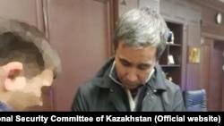 Казахстанский бизнесмен Муратхан Токмади, обвиняемый в совершении «заказного» убийства банкира Ержана Татишева, после задержания. Фото с сайта комитета национальной безопасности (КНБ) Казахстана.