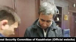 Токмадини кармоо учурунда тартылган видеотасмадан алынган сүрөт.