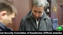 Бизнесмен Муратхан Токмади, обвиняемый в совершении заказного убийства банкира Ержана Татишева, после задержания. Фото с сайта комитета национальной безопасности Казахстана.