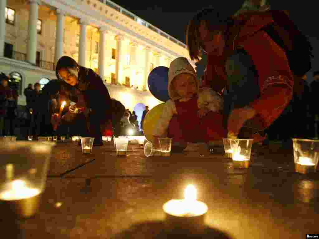 People light candles during a flashmob to mark the Day of Ukrainian Language in Kyiv on November 9. Photo by Konstantin Chernichkin for Reuters