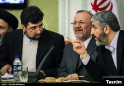 Ghazanfar Roknabadi (L) with Khaled Mashal of Hamas (R) and for Iranian foreign minister Manouchehr Mottaki. Undated