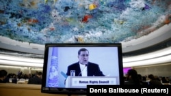 Seyyed Ali Reza Avayi, Minister of Justice of Iran appears on screen as he attends the Human Rights Council at the United Nations in Geneva, Switzerland, February 27, 2018.