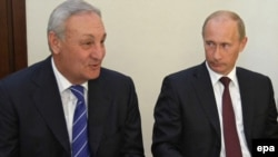 "Abkhaz leader Sergei Bagapsh (left, with Russian Prime Minister Vladimir Putin earlier this month) said Abkhaz ships would ""destroy"" Georgian ships."