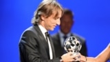 MONACO -- Real Madrid Croatia's midfielder Luka Modric receives the UEFA champions league midfielder of the season award during the draw for UEFA Champions League football tournament at The Grimaldi Forum in Monaco, August 30, 2018