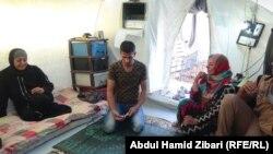 اسرة فلسطينية نازحة الى كردستان
