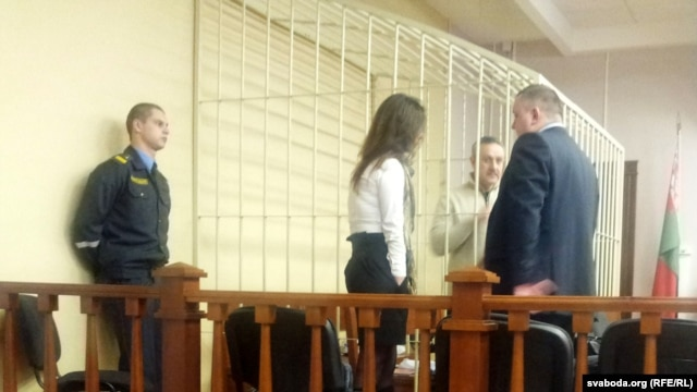 Yuri Dorn in a court cage as his trial gets under way in Minsk.