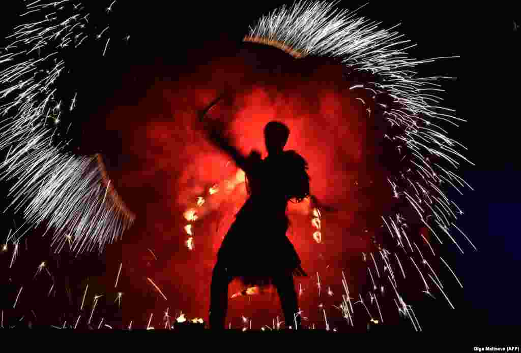 An actor performs a fire show in downtown St. Petersburg, Russia. (AFP/Olga Maltseva)