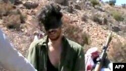 Журналист Остин Тайс с похитителями. 2012 год. Скриншот из видео YouTube.