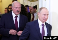 Belarusian President Alyaksandr Lukashenka (left) and his Russian counterpart Vladimir Putin in St. Petersburg last month.
