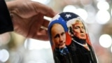 RUSSIA -- A vendor shows a traditional Russian wooden nesting doll, Matryoshka doll, depicting Russia's President Vladimir Putin and US President and Republican presidential nominee Donald Trump at a gift shop in central Moscow on November 3, 2020. (Photo