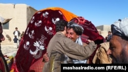 An bridegroom receiving friends to his wedding in southern Afghanistan.