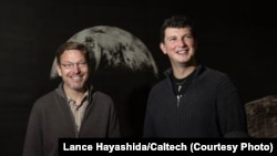 """Russian astronomer Konstantin Batygin (right) and his colleague Mike Brown (left) have published their research in the hope that the public can help them find our solar system's """"ninth planet."""""""