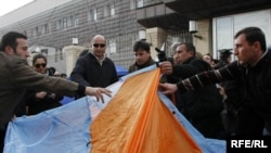 Opposition supporters set up tents around the presidential residence in Tbilisi.