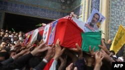 People carry the coffin of Mohammad Jamali Paqale, an officer of the Revolutionary Guards reportedly killed in fighting in the Syrian capital Damascus, during his funeral in the southern city of Kerman in November 2013.