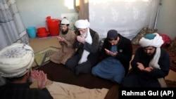 FILE: Taliban prisoners pray inside the Pul-e-Charkhi jail in Kabul in December 2019.