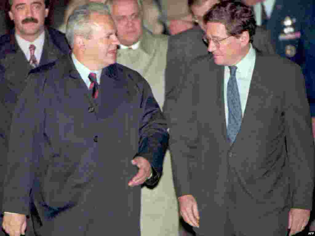 Serbian President Slobodan Milosevic is greeted by U.S. Assistant Secretary of State Richard Holbrooke after arriving at Wright-Patterson Air Force Base near Dayton on October 31, 1995, to attend the Balkan peace talks.