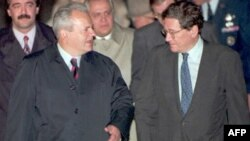 Serbian President Slobodan Milosevic (left) is greeted by U.S. Assistant Secretary of State Richard Holbrooke after arriving at Wright-Patterson Air Force Base near Dayton, Ohio, on October 31, 1995.