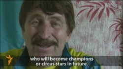 Kazakh Acrobat Demands Education Role