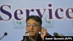 Pakistani Finance Minister Asad Umar speaks at a news conference in Islamabad on October 25.