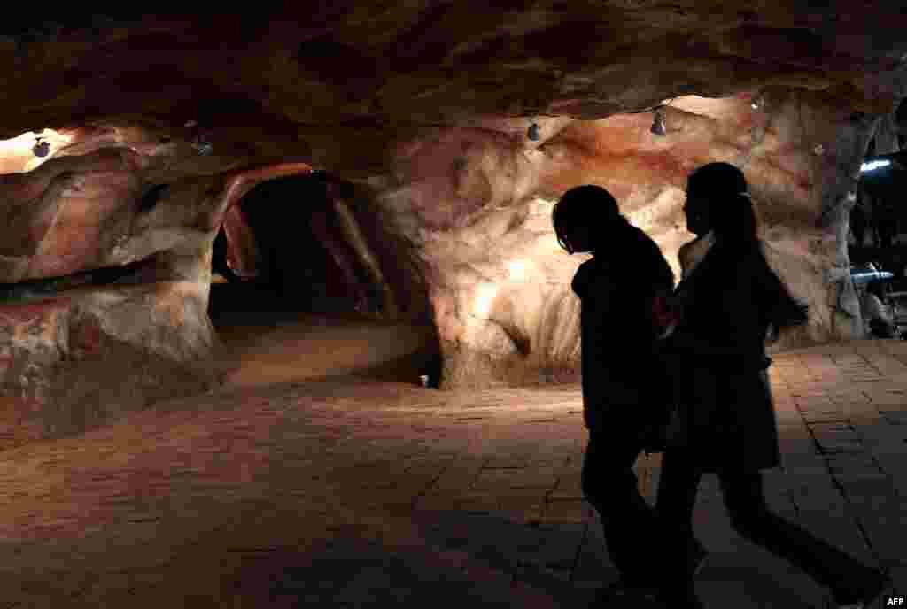 Schoolgirls explore a tourist area inside the Khewra mine.