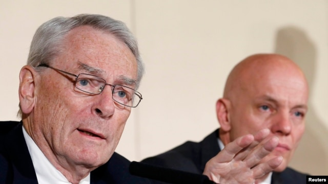 "The WADA investigative commission's chairman, Dick Pound (left), said at a press conference at the time that it would be ""impossible"" for Mutko not to have known about Russia's doping program."