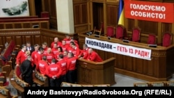 Ukrainian opposition politicians have occupied the parliament's podium for more than two weeks.