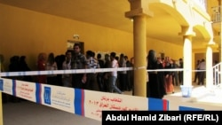 People line up to vote in regional parliamentary elections in Iraq's autonomous Kurdish region on September 21.