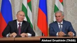 Russian President Vladimir Putin (left) meets with Raul Khajimba, the leader of Georgia's breakaway region of Abkhazia, on August 8.