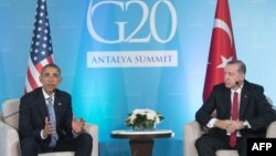 U.S. President Barack Obama (left) speaks as Turkish President Recep Tayyip Erdogan looks on during a meeting on the sidelines of the G20 summit in Antalya on November 15.