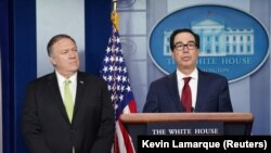 U.S. Secretary of State Mike Pompeo (left) and Treasury Secretary Steven Mnuchin announce the new sanctions at the White House.