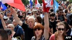 Demonstrators protest in front of the parliament building in Warsaw on July 16 against new legislation that reorganizes Poland's judiciary-