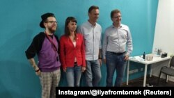 Ресейлік оппозициялық саясаткер Алексей Навальный және Ксения Фадеева.