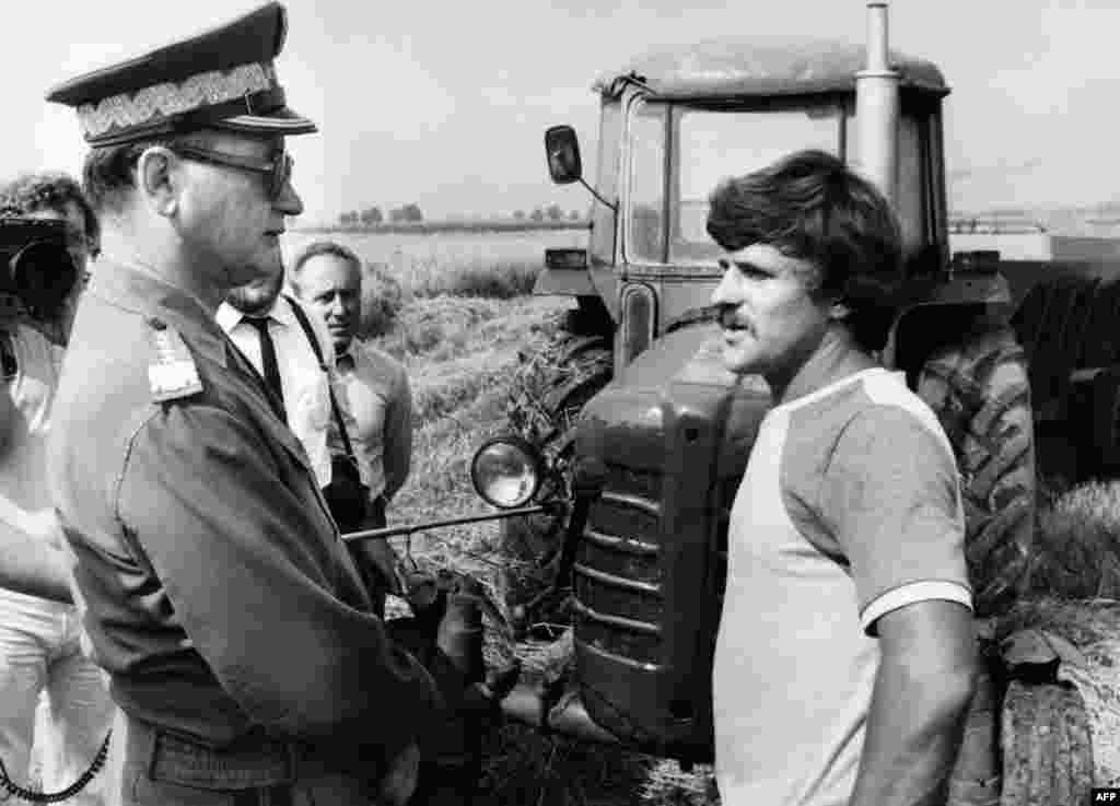 An undated photograph shows Jaruzelski (left) talking with farmer Krzyszto Zoltaski in a photo op from the village of Krolewo.
