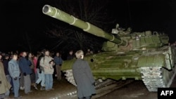 A Lithuanian demonstrator stands in front of a Soviet tank in January 1991.