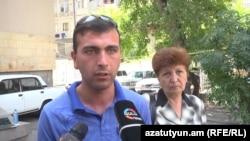 Armenia - Vaghinak Shushanian and his mother. Yerevan, 25Jul, 2014