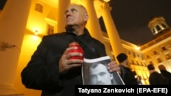 Mikalay Statkevich attends a rally to commemorate victims of Stalin's political repressions outside KGB headquarters in Minsk on October 29.