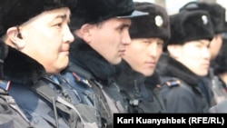 Police were on hand to keep a close eye on the opposition demonstration in Almaty on February 25.