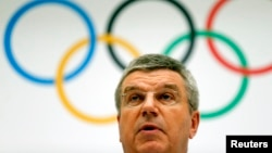 International Olympic Committee President Thomas Bach announces the 2022 Olympic Winter Games candidate cities at IOC headquarters in Lausanne on July 7, 2014.