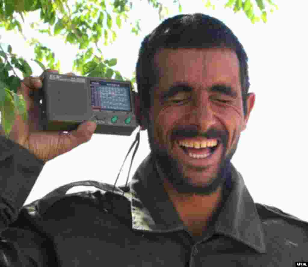A radio listener in Afghanistan. Radio Free Afghanistan is the most popular radio station in the country.